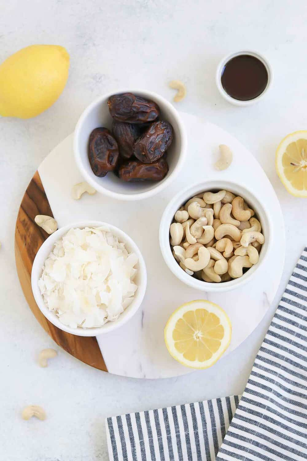 Ingredients for this recipe arranged in white bowls on a white circle platter.