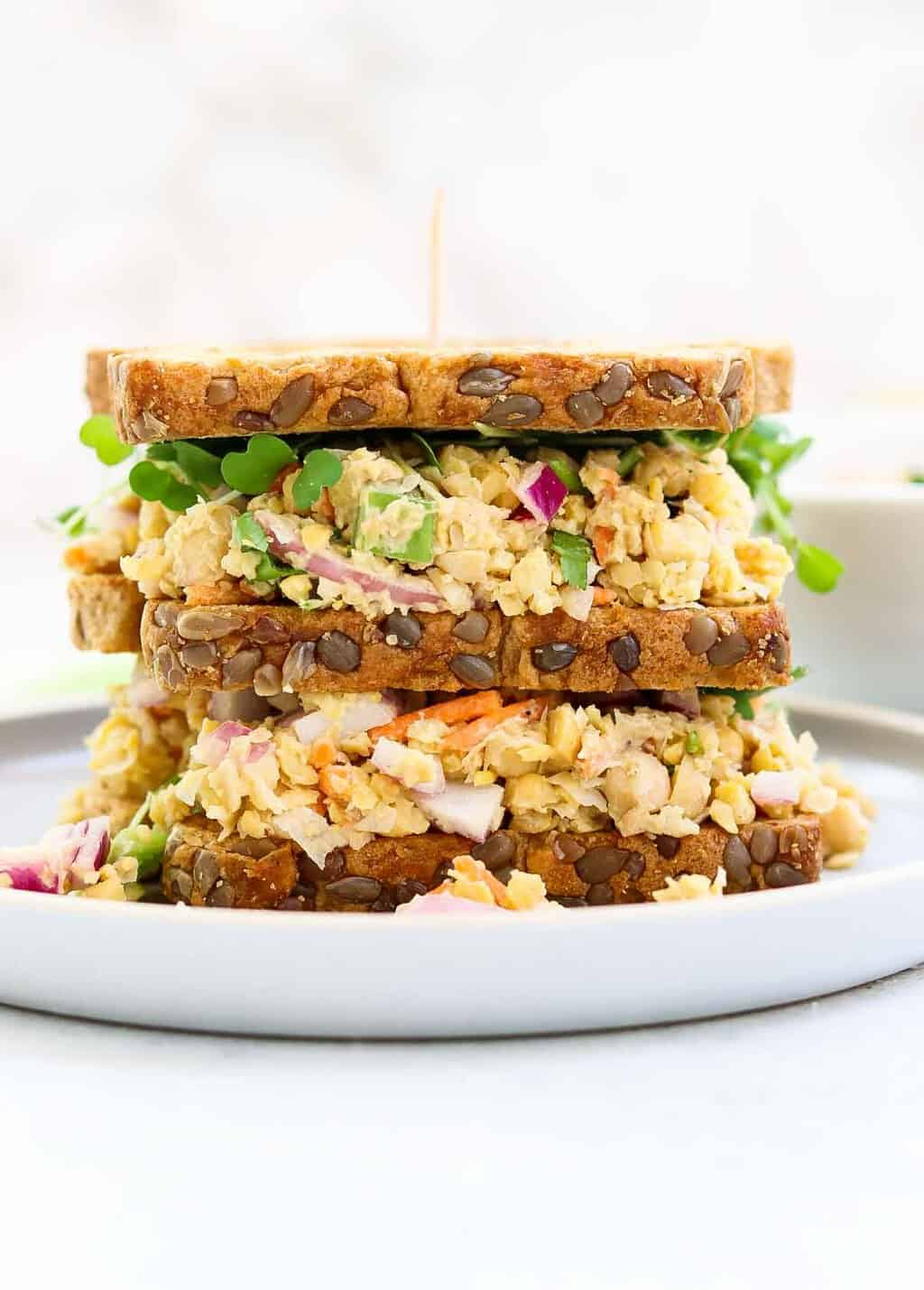 Chickpea tuna salad sandwich on a blue plate.
