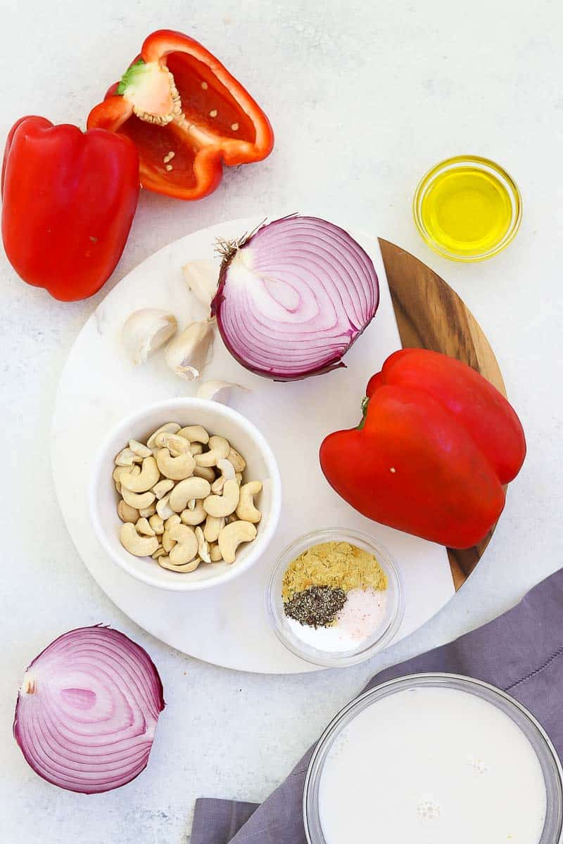 Ingredients for the pasta arranged on a white backdrop.