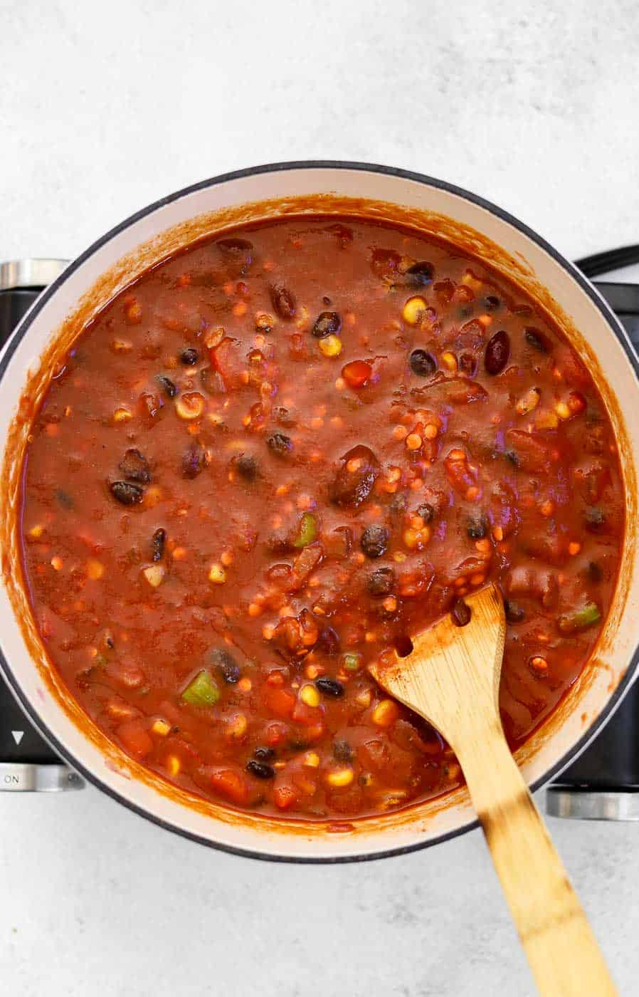 Lentil chili in a pot before cooking.