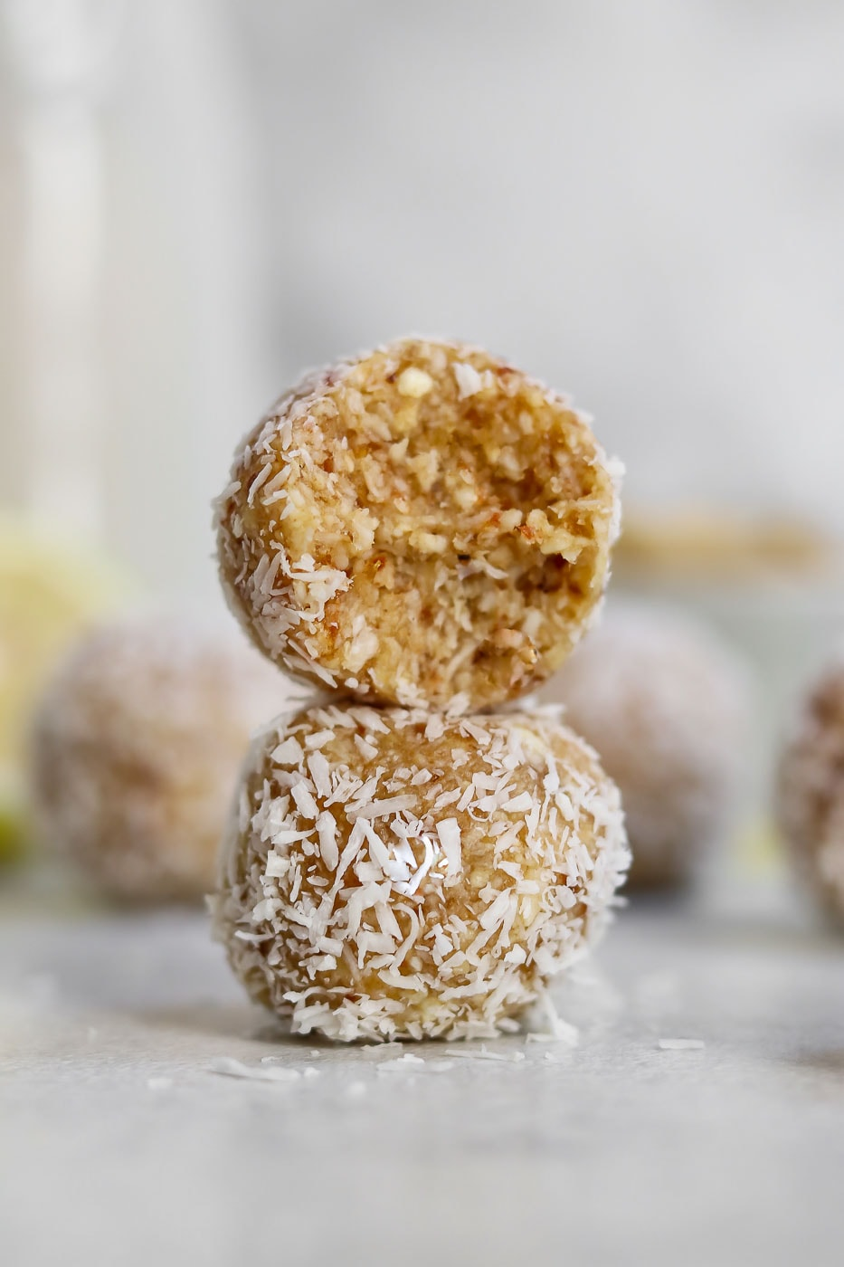 Two energy balls stacked on each other with one bite taken out.