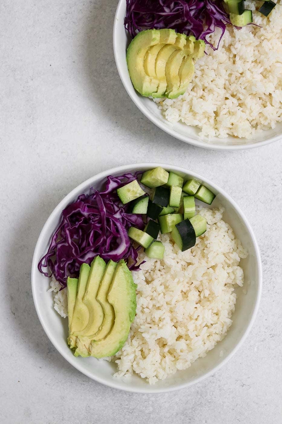 White rice with avocado and veggies.