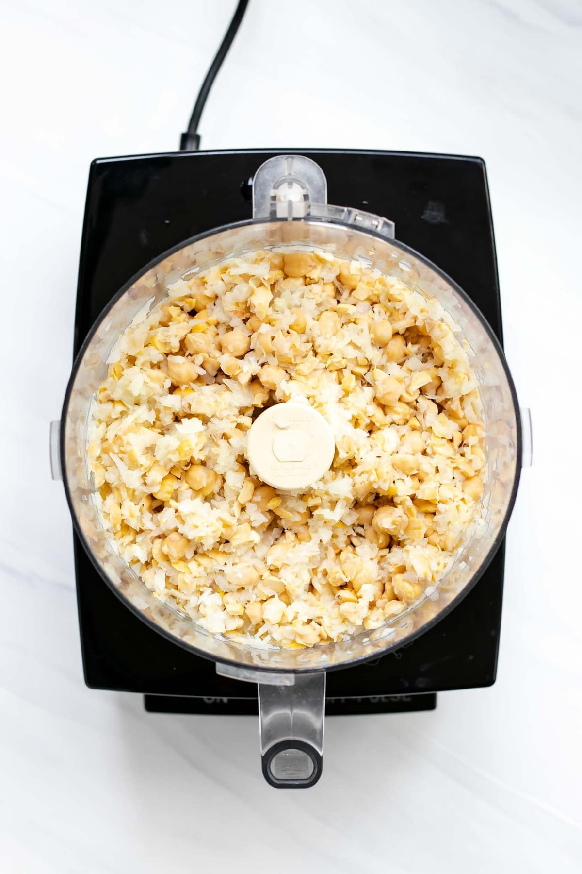Onion and chickpeas chopped in the food processor,