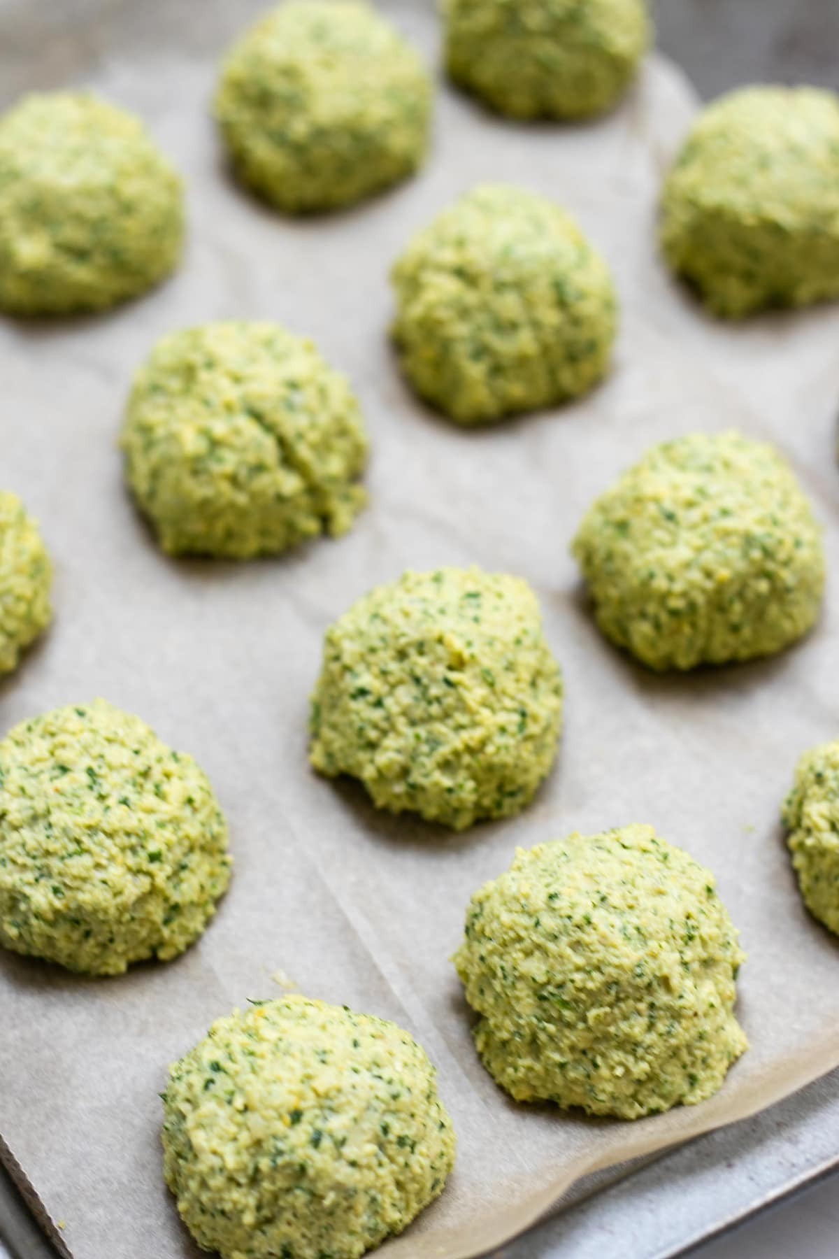 Falafel before going in the oven on a cookie sheet,