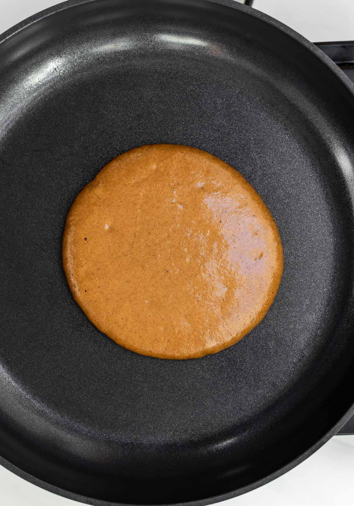 Pancake cooking on a pan.