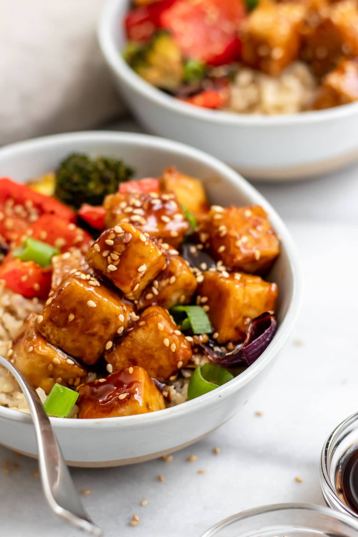 Sesame tofu with sesame seeds in a small bowl.