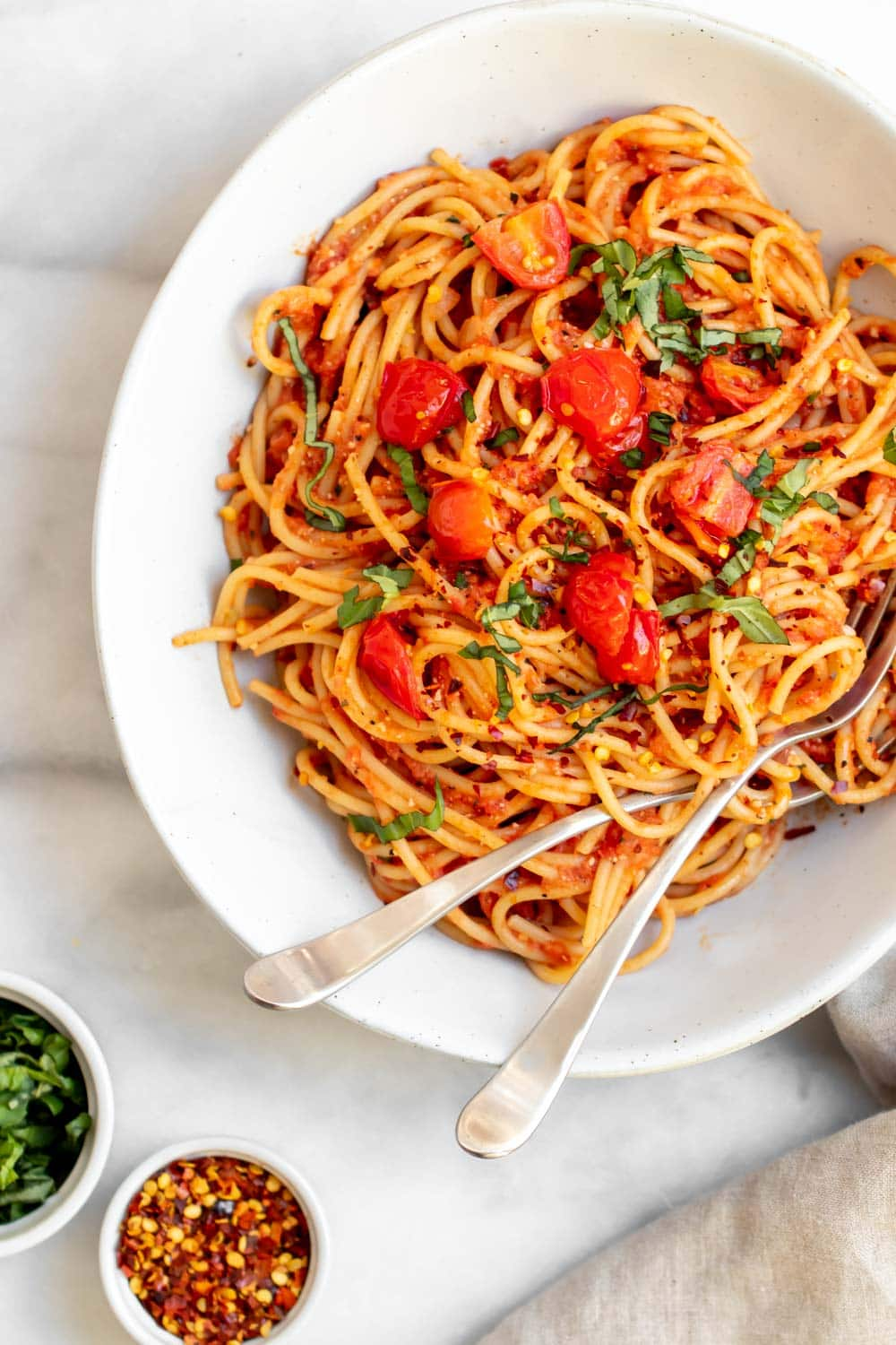 Vegan spaghetti sauce with fresh basil and red pepper flakes.
