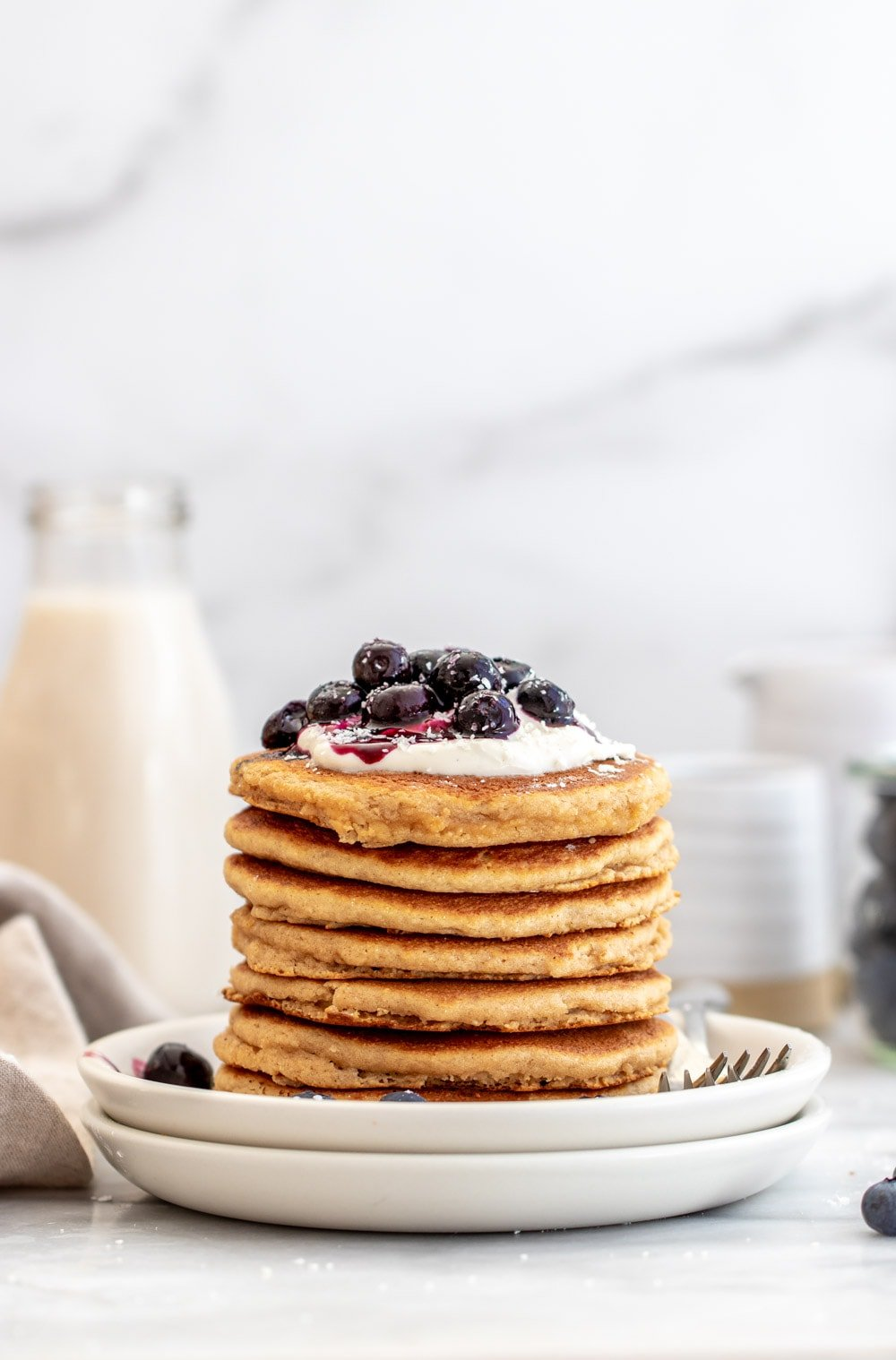 Almond flour pancakes with blueberries on top.