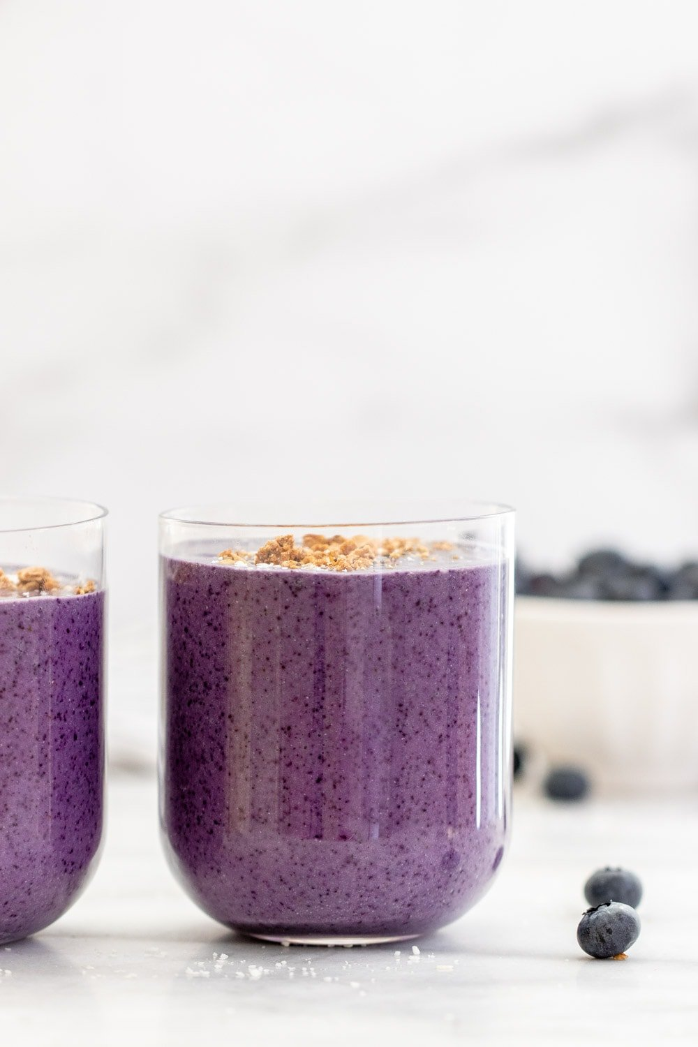 Blueberry avocado smoothie in a short glass.