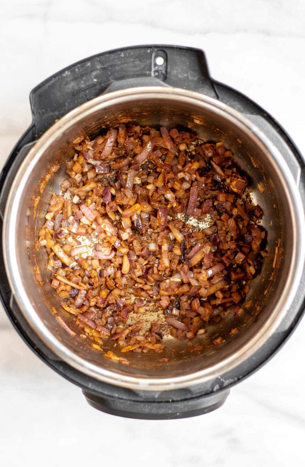 Onion and garlic with spices in the pot.