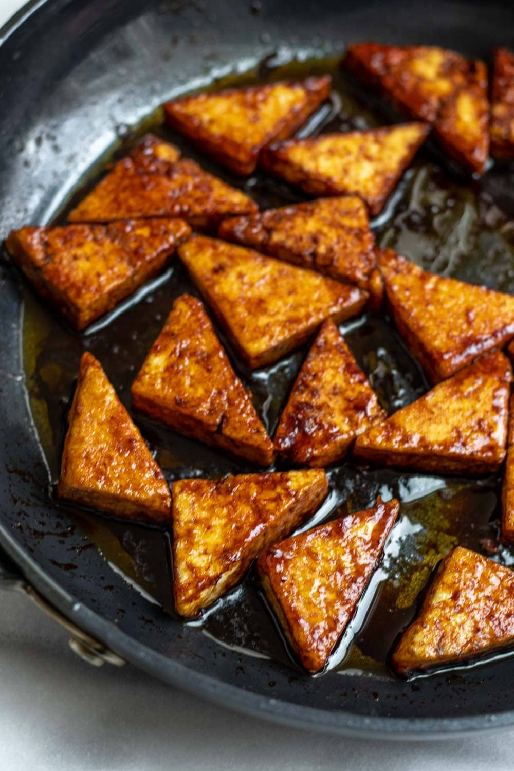 Spicy tofu in the pan with sauce.