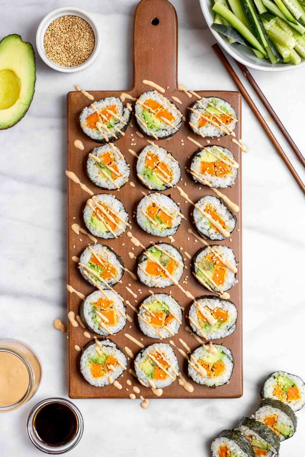 Vegetarian sushi recipe with sweet potato on a wood board.