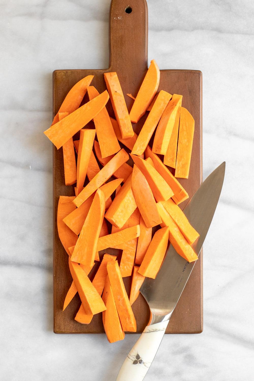 Sliced sweet potato on a cutting board,