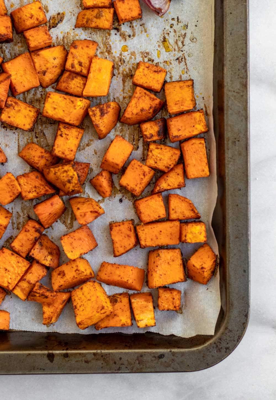 Overhead shot of roasted sweet potatoes on a baking sheet.