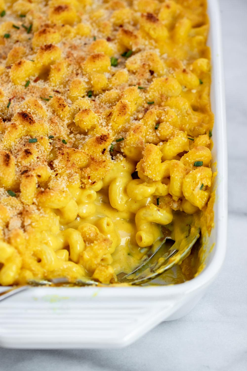 Vegan mac and cheese in a white baking dish.
