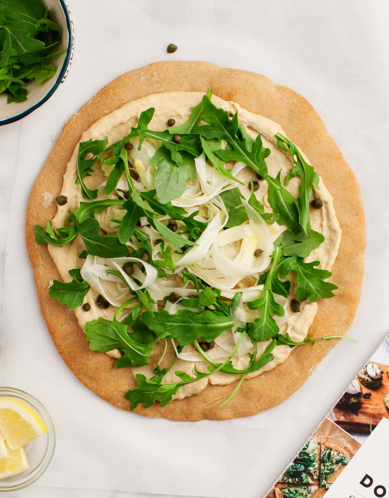 Chickpea crust pizza with arugula.