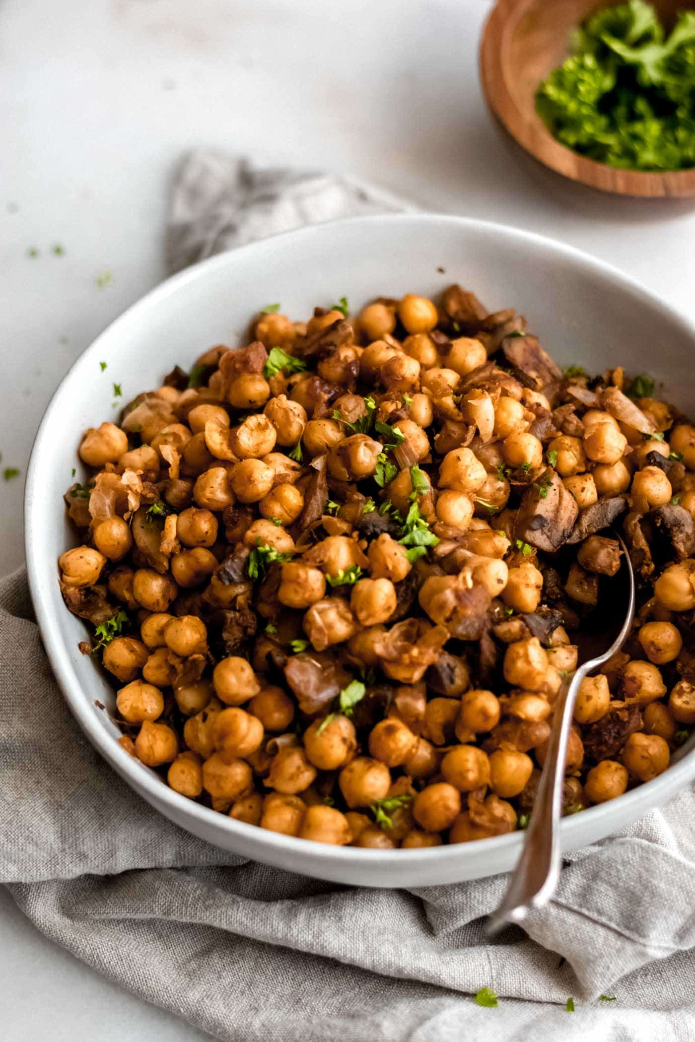 Spiced chickpeas in a large white bowl.