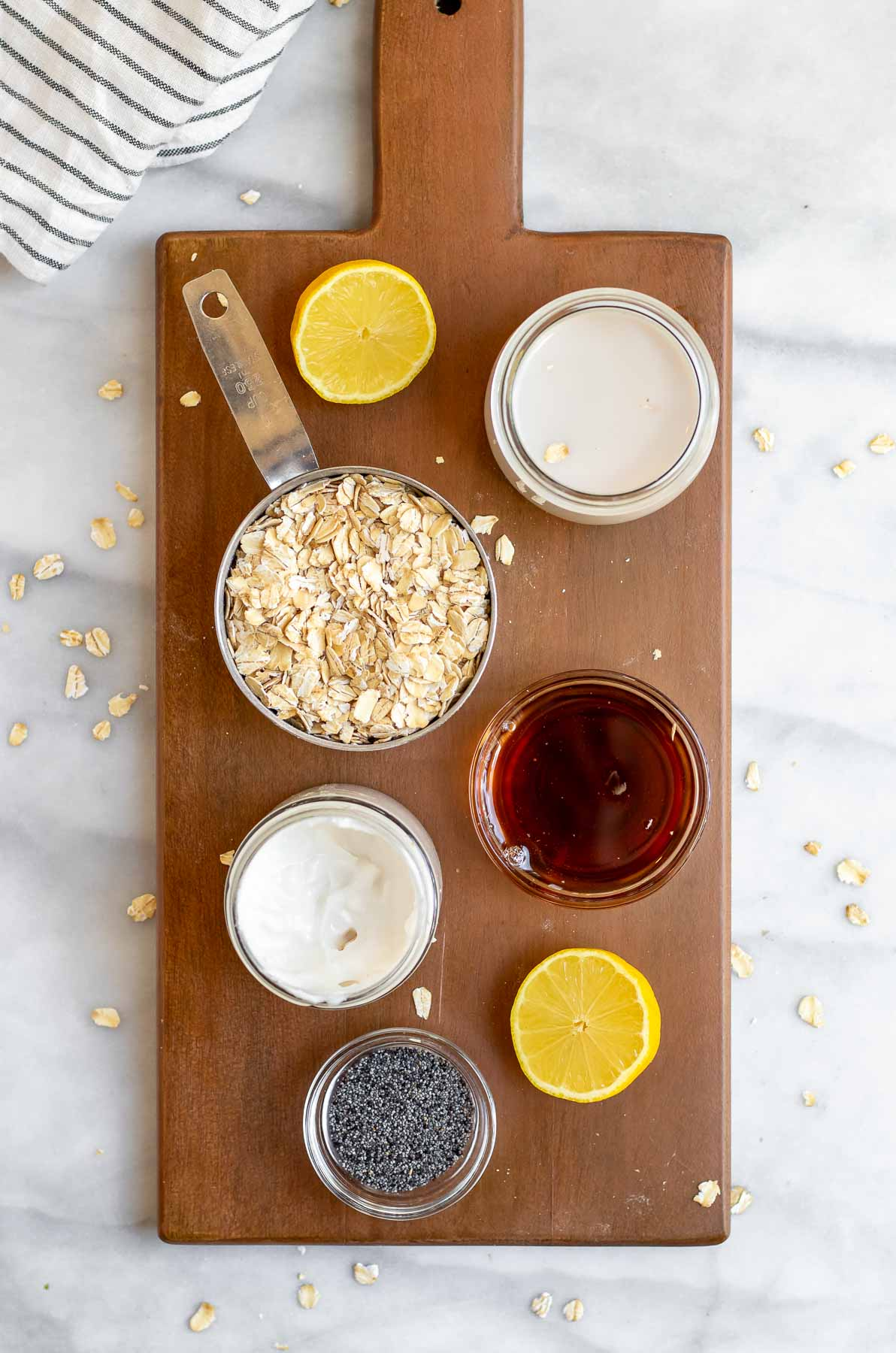 Overnight oat ingredients on a wooden board.