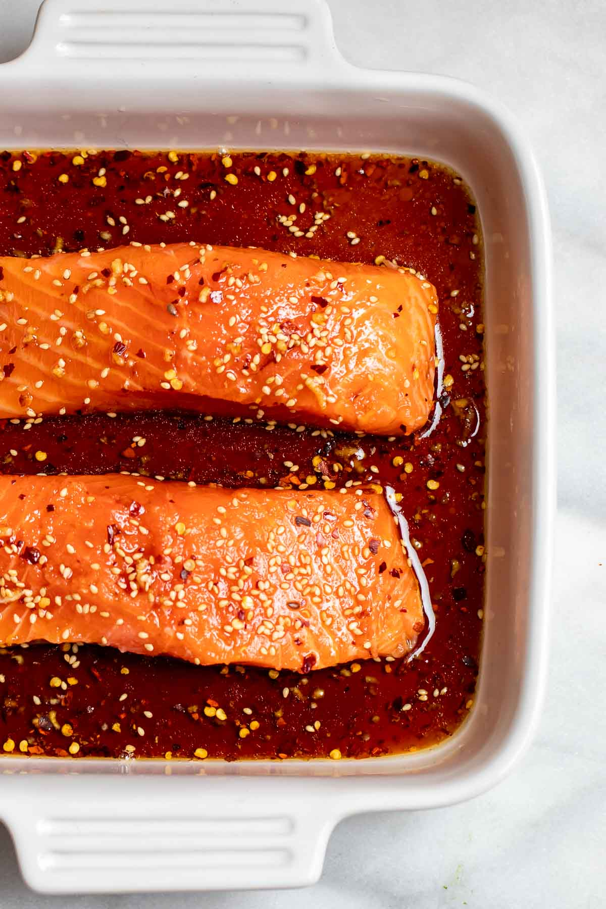 Salmon marinating in a baking dish,