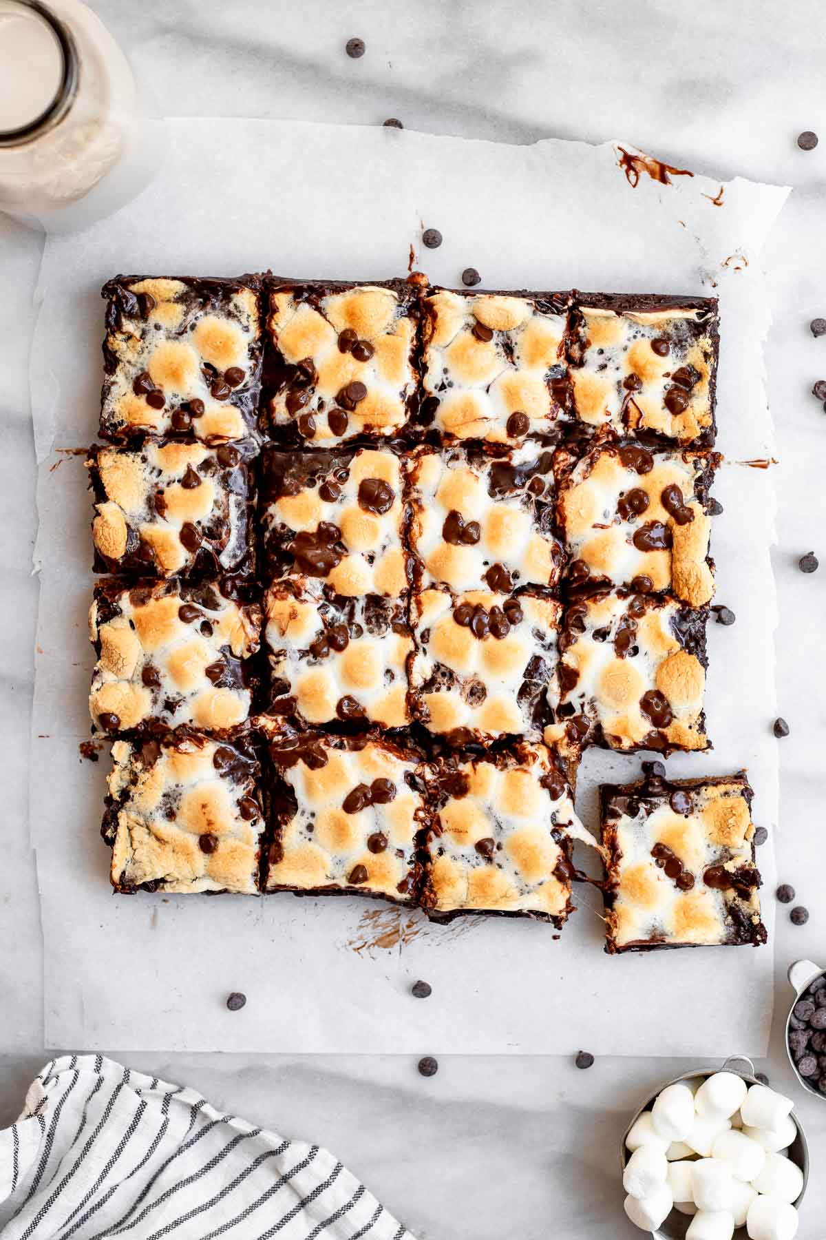 Overhead shot of smores bars with marshmallows on the side.
