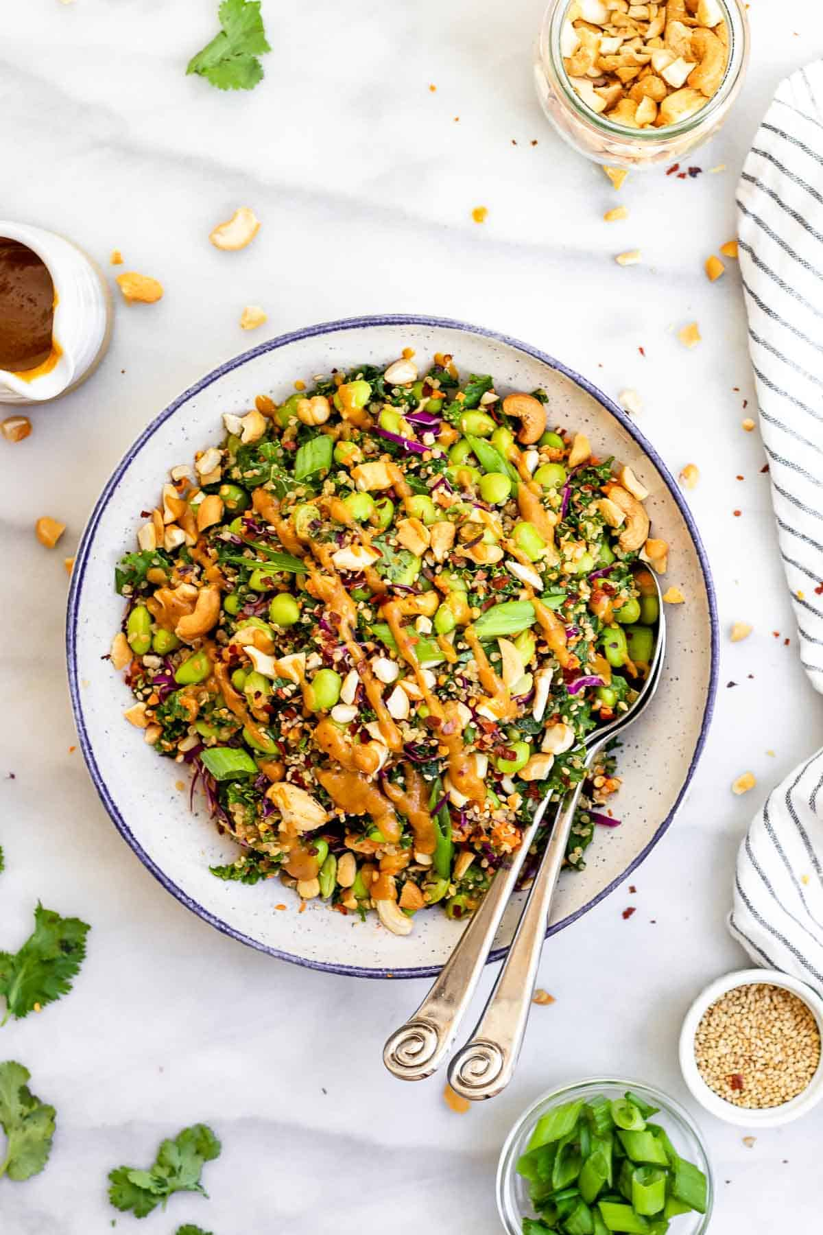Edamame salad in a large bowl with asian peanut dressing.