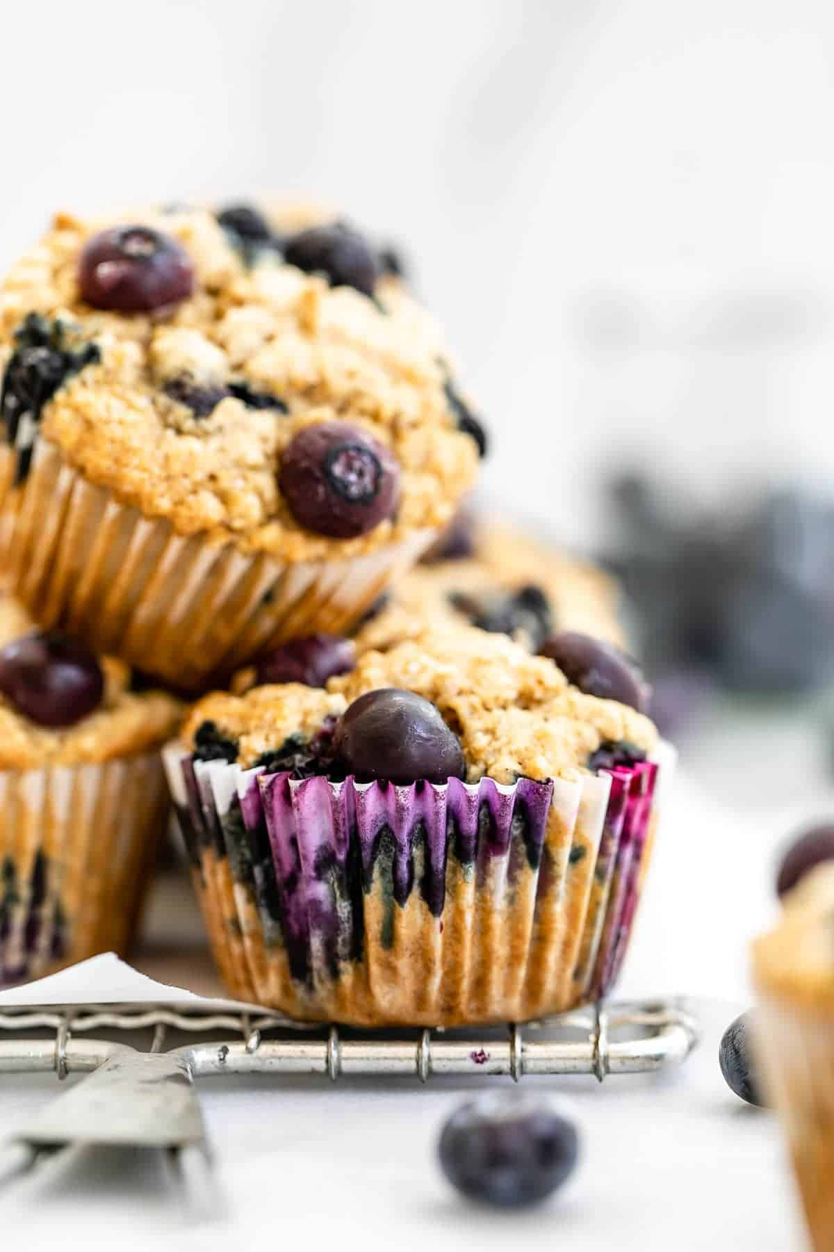 Blueberry oatmeal muffins stacked on each other.