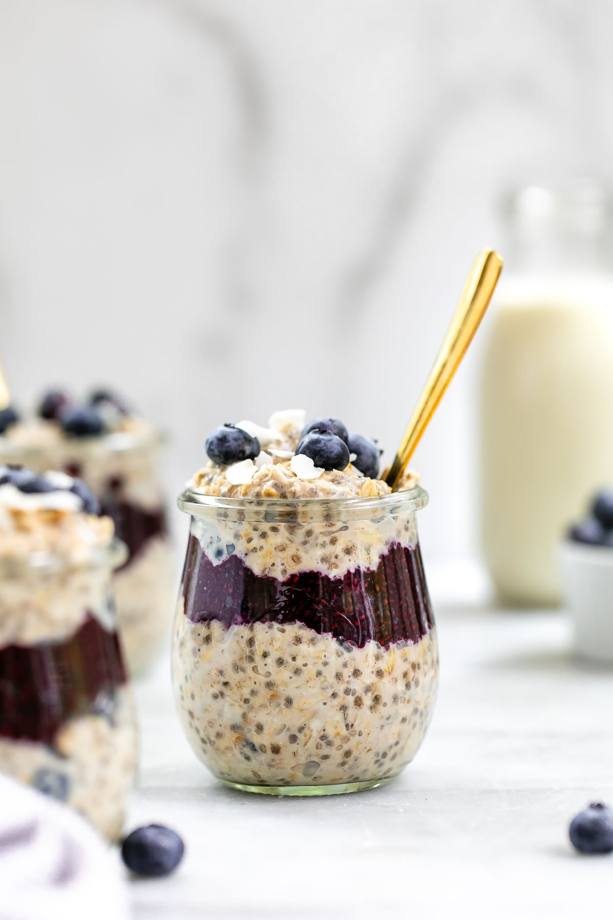 Up close image of blueberry overnight oats with coconut flakes on top.