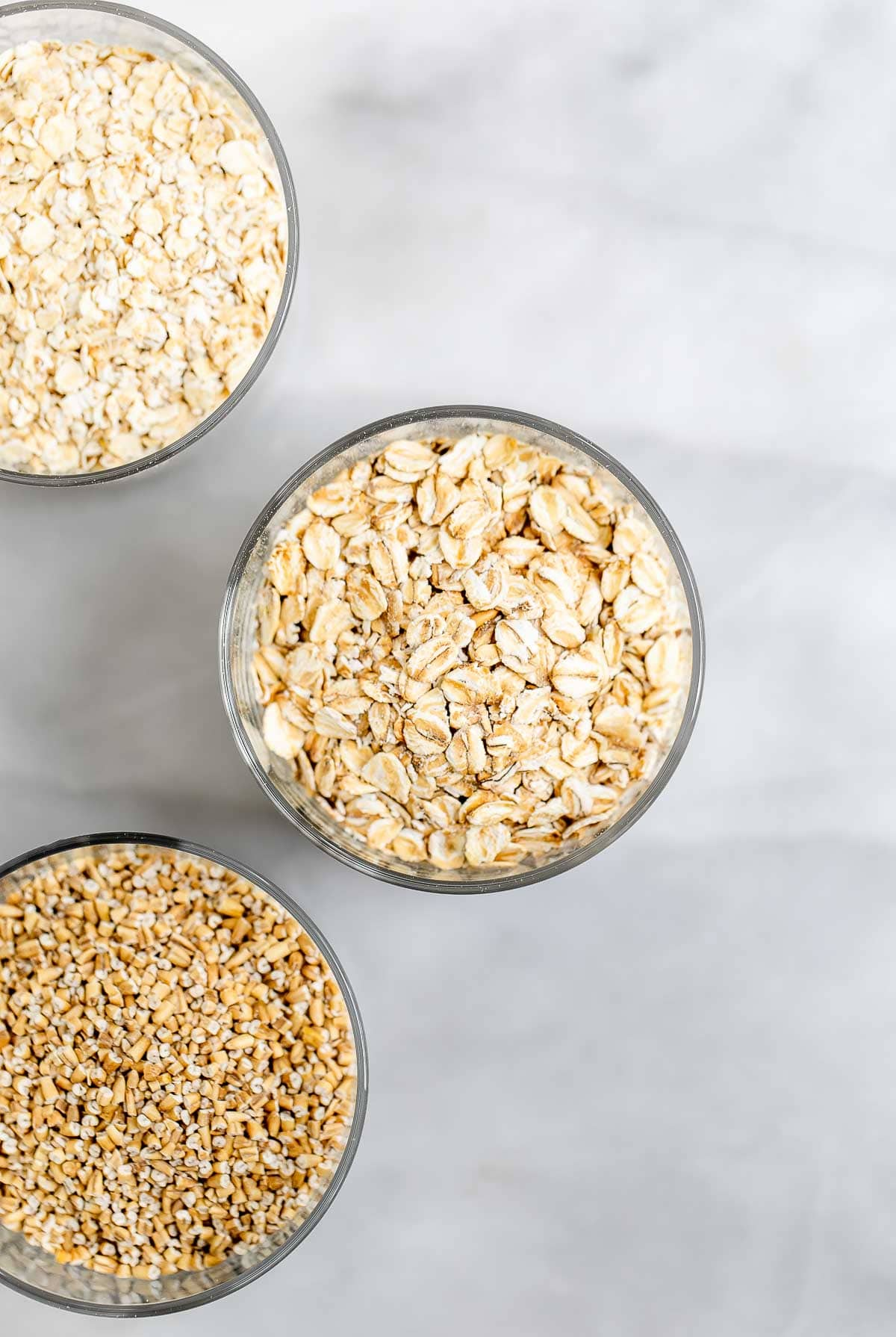 Three jars with different types of oats.