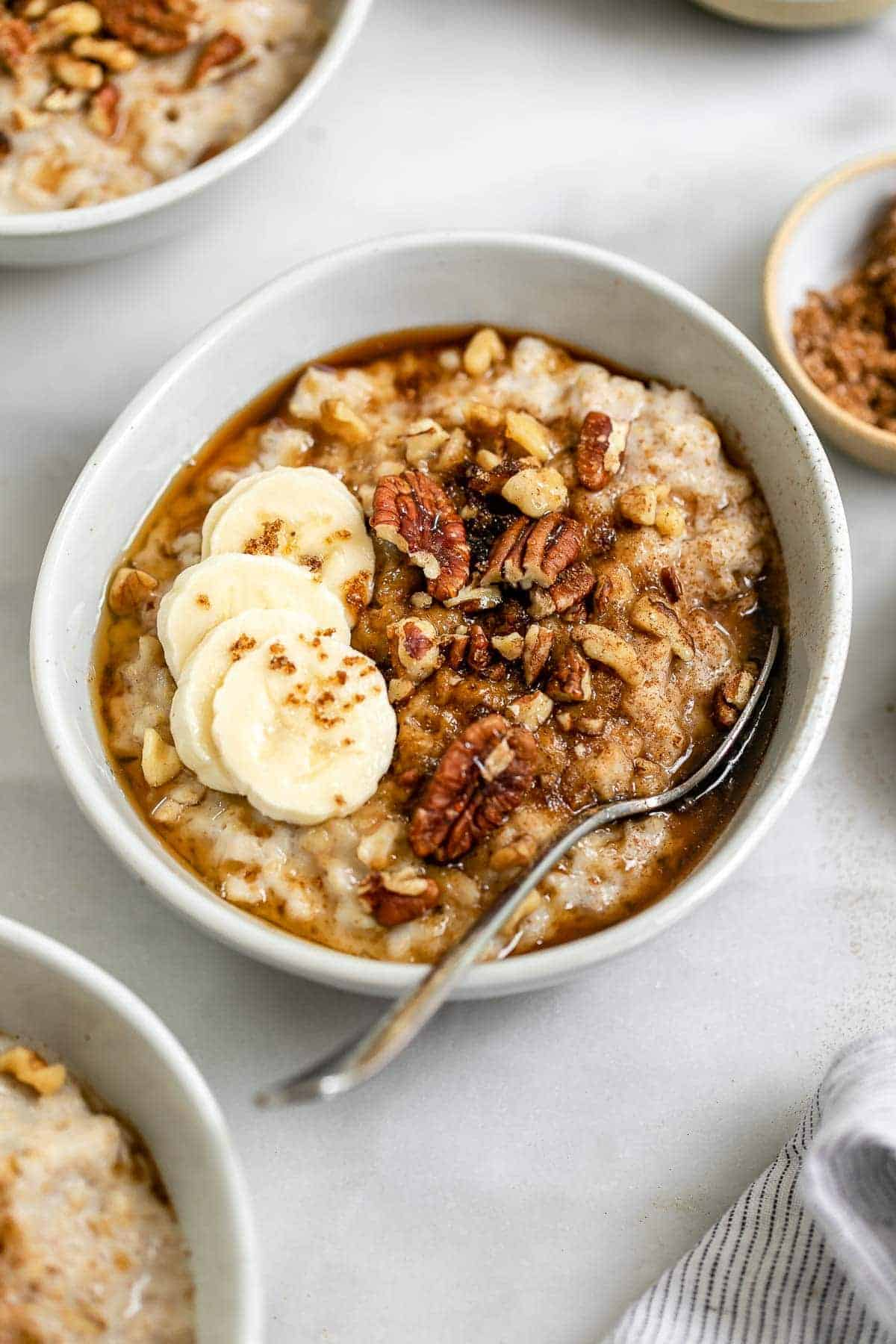 Brown sugar oatmeal in a bowl with a spoon on the side.