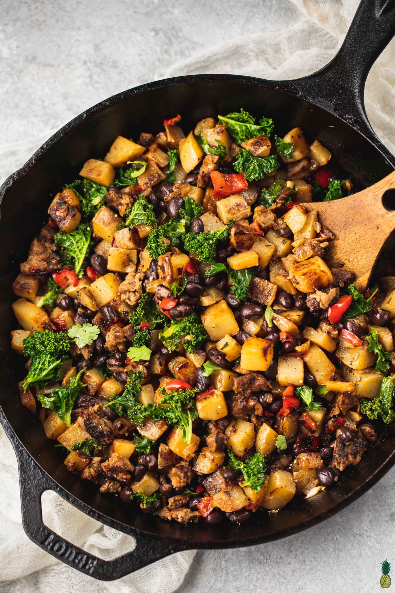 Breakfast hash in a large skillet.