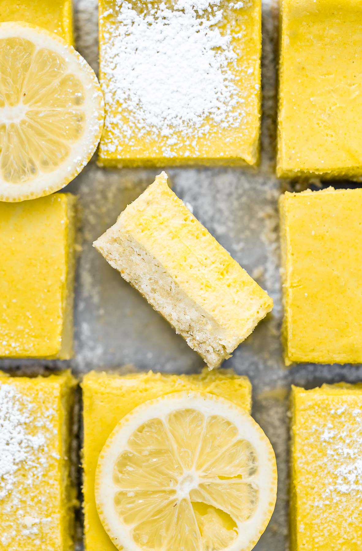 Lemon bars with one on the side to show the texture and crust.