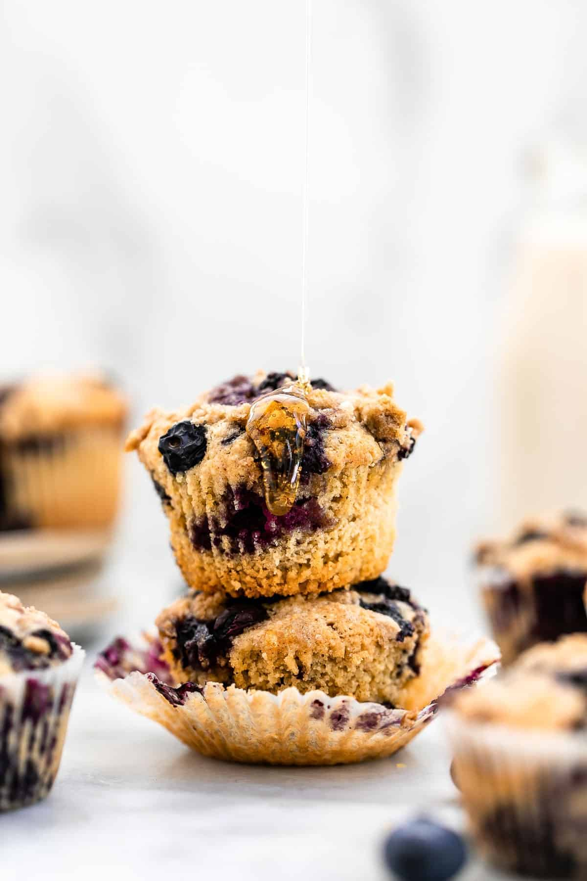 Honey dripping down a blueberry muffin.
