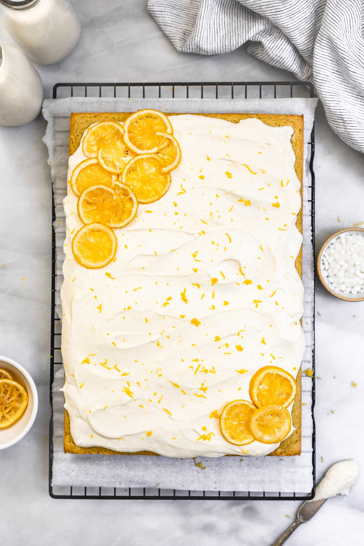 Overhead shot of lemon cake with candied lemons on the side.