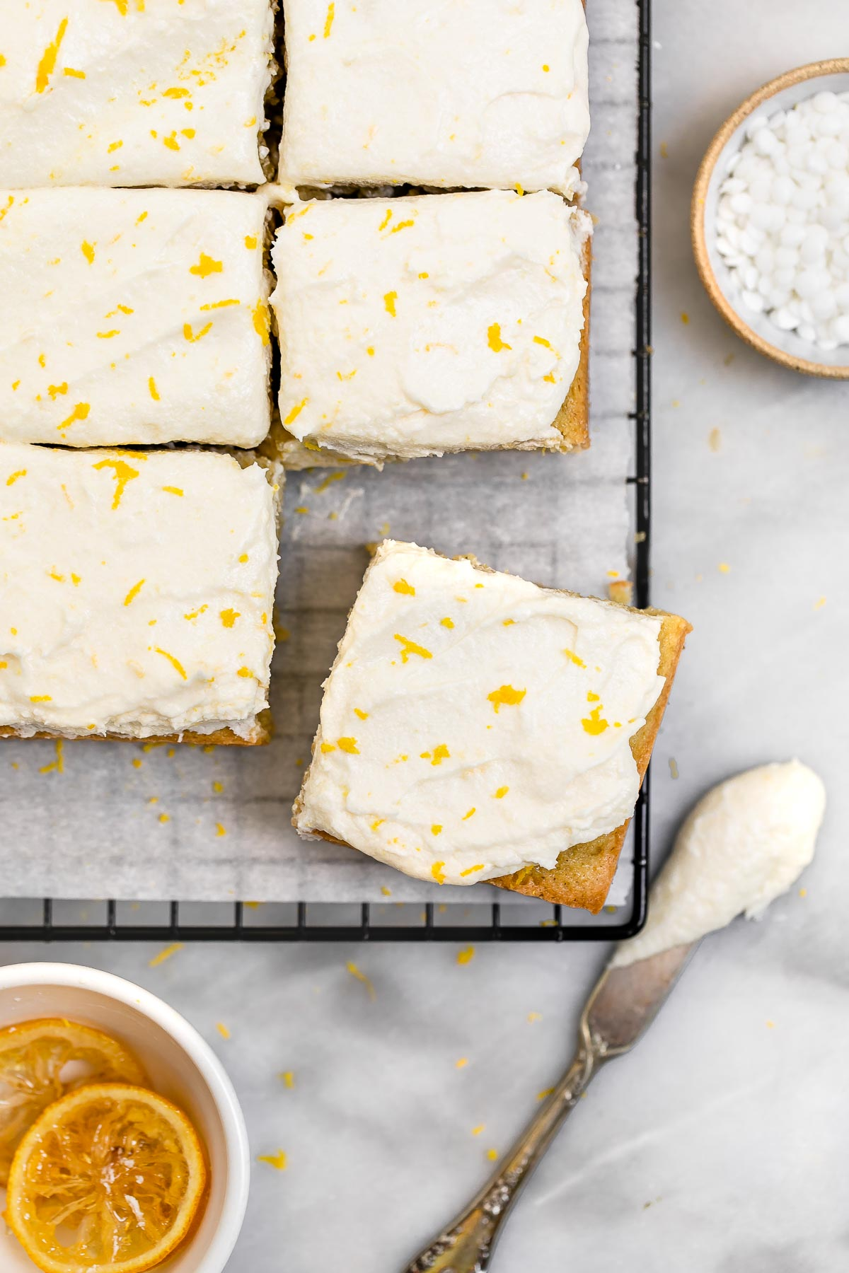 Gluten free lemon cake sliced into squares.