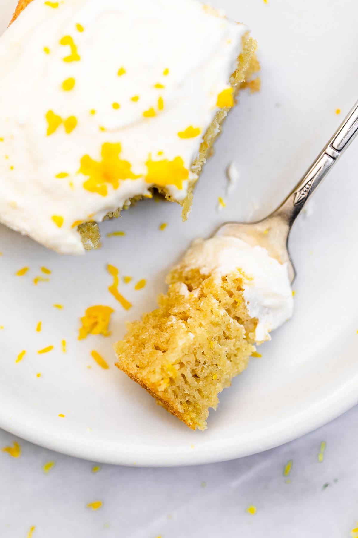 One bite of the gluten free lemon cake on a fork.