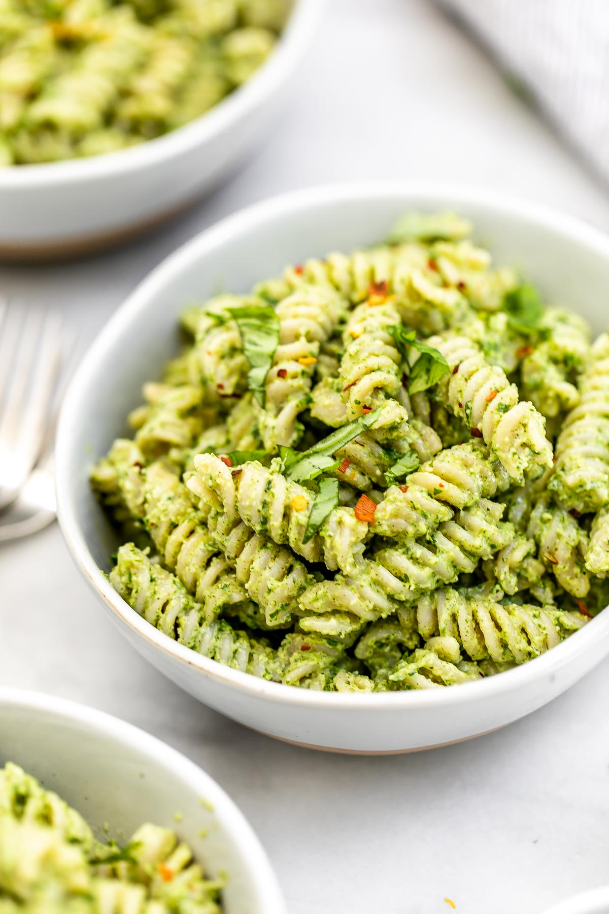 Angled view of vegan nut free pesto pastas.