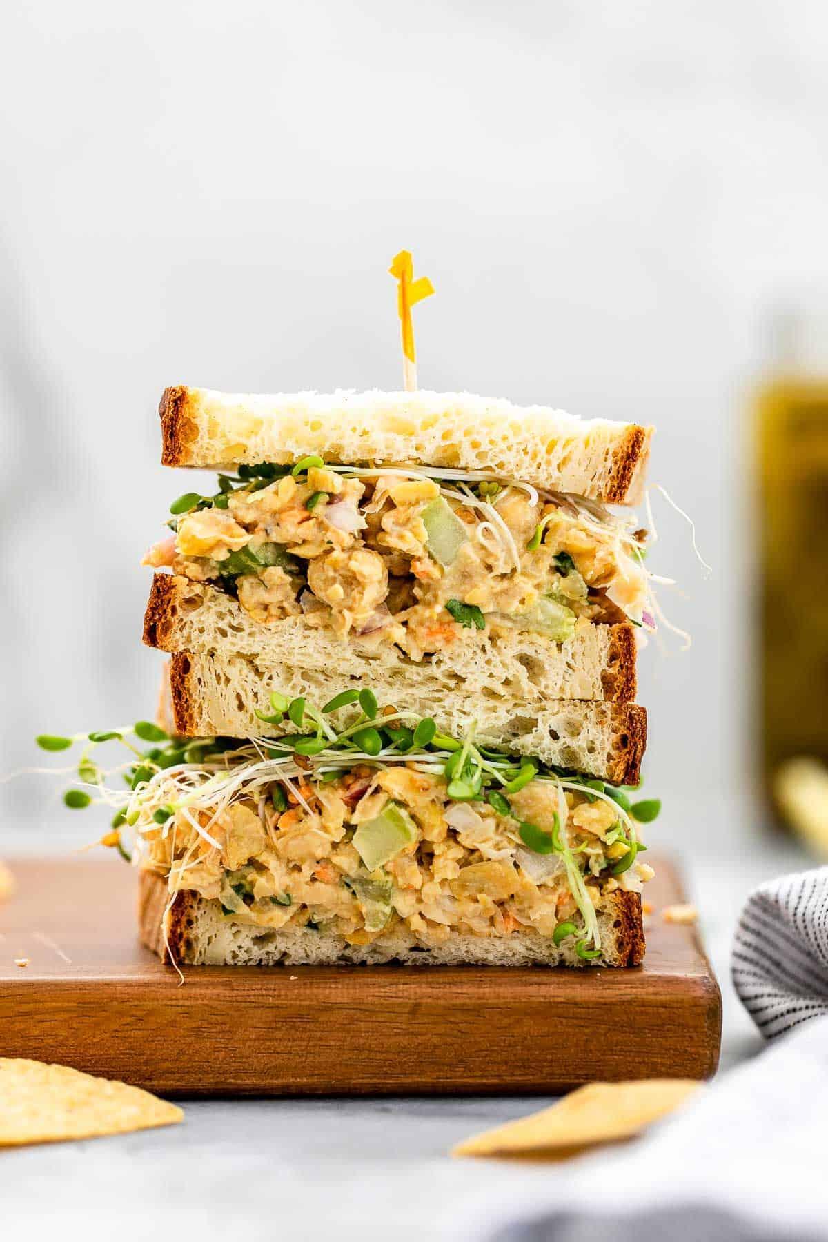 Vegan tuna salad sandwich on a wood board.