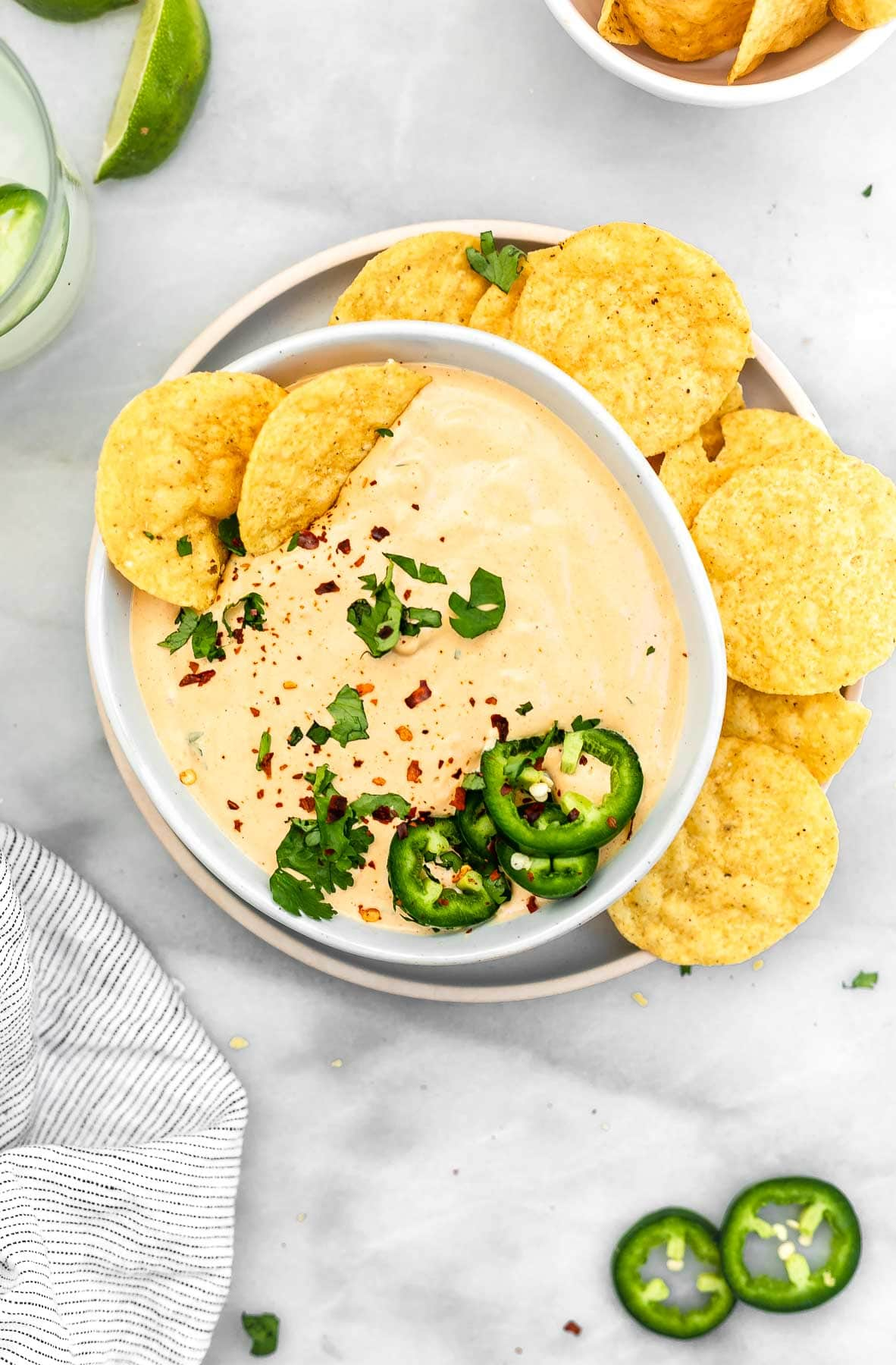 Cashew queso in a bowl with jalapeno.
