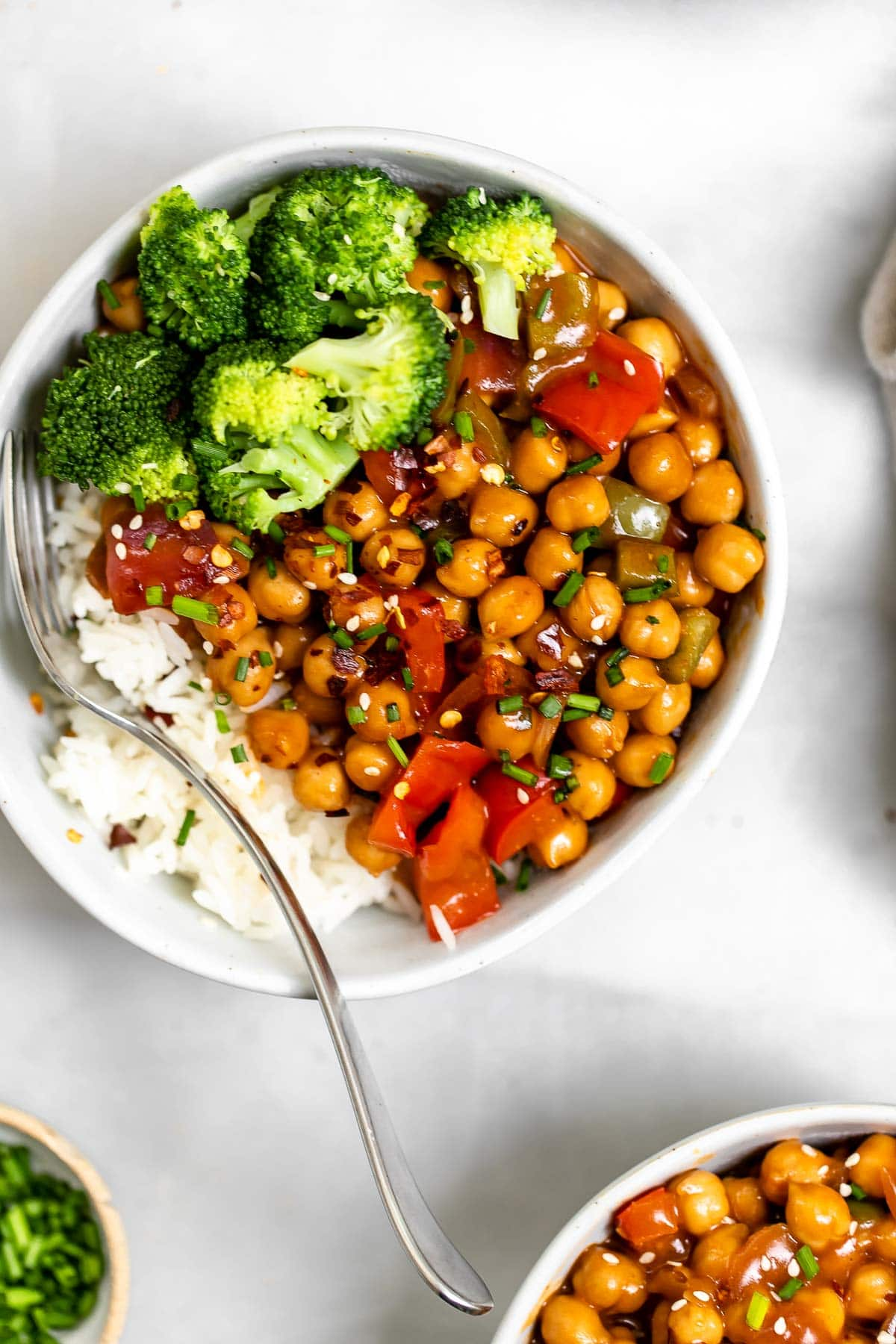 Chickpea buddha bowl with a fork on the side.