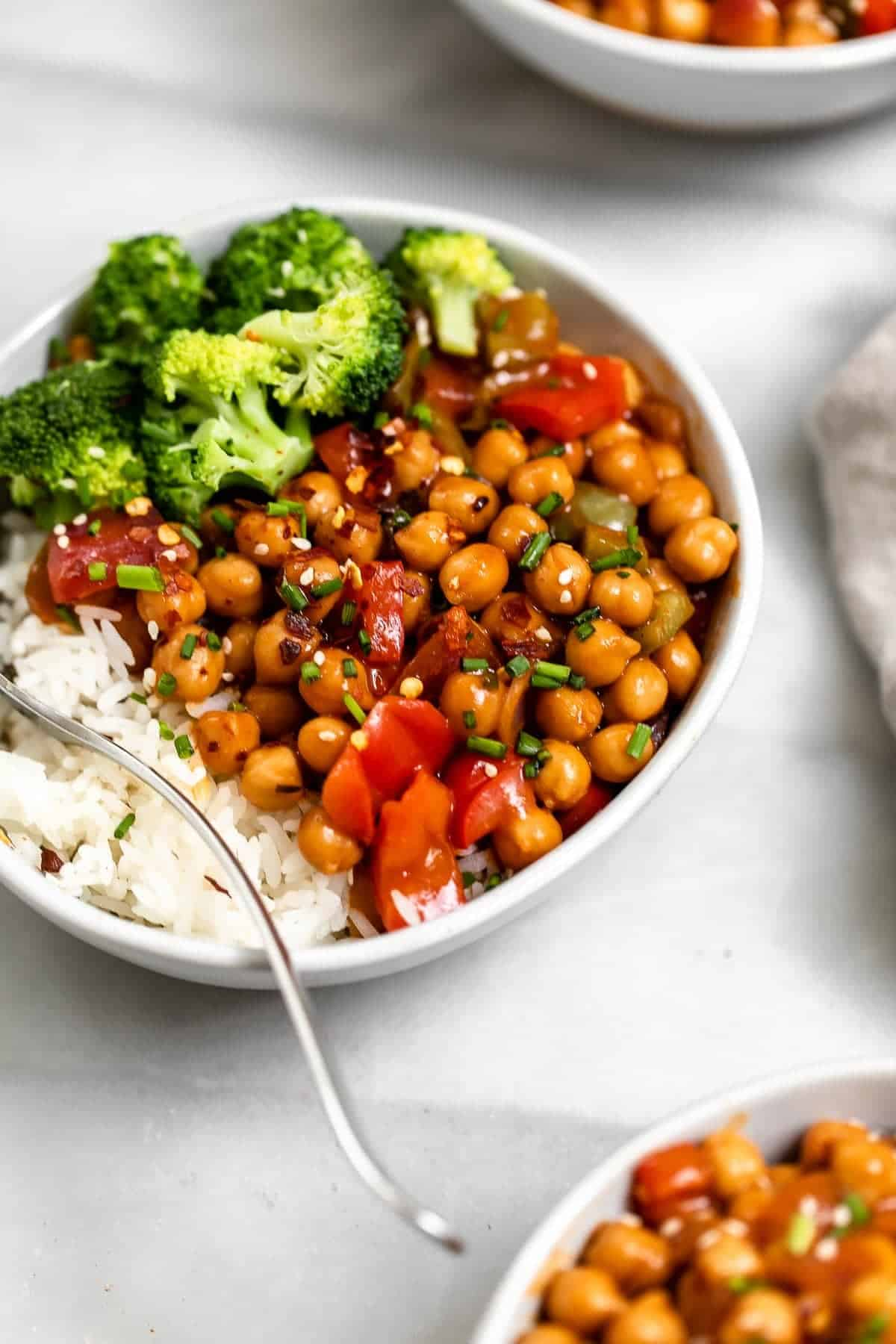 Vegan chickpea stir fry with steamed broccoli on the side.