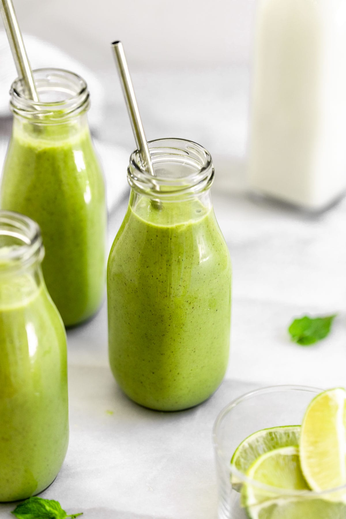 Healthy green smoothie with spinach in a glass jar.