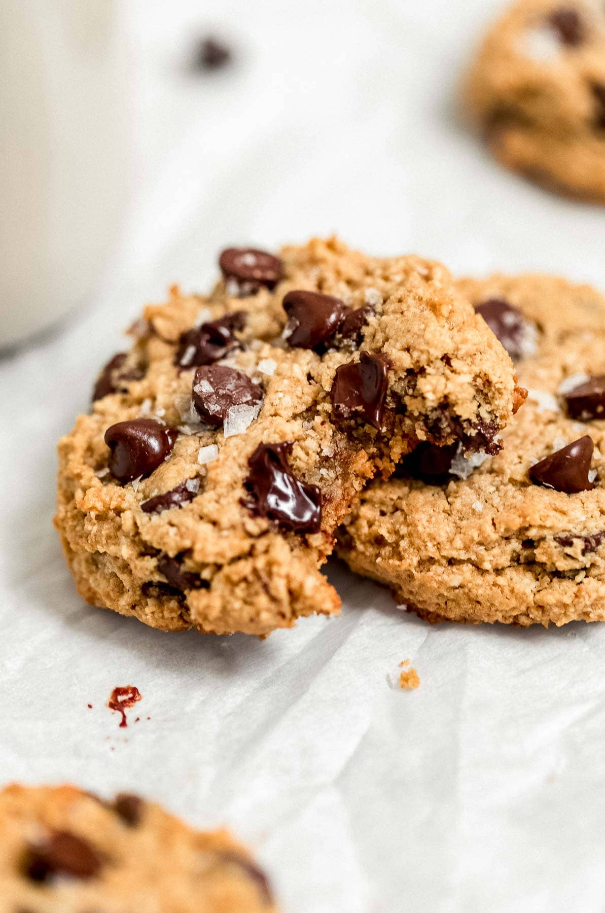 Melted chocolate chip dripping down a healthy cookie.