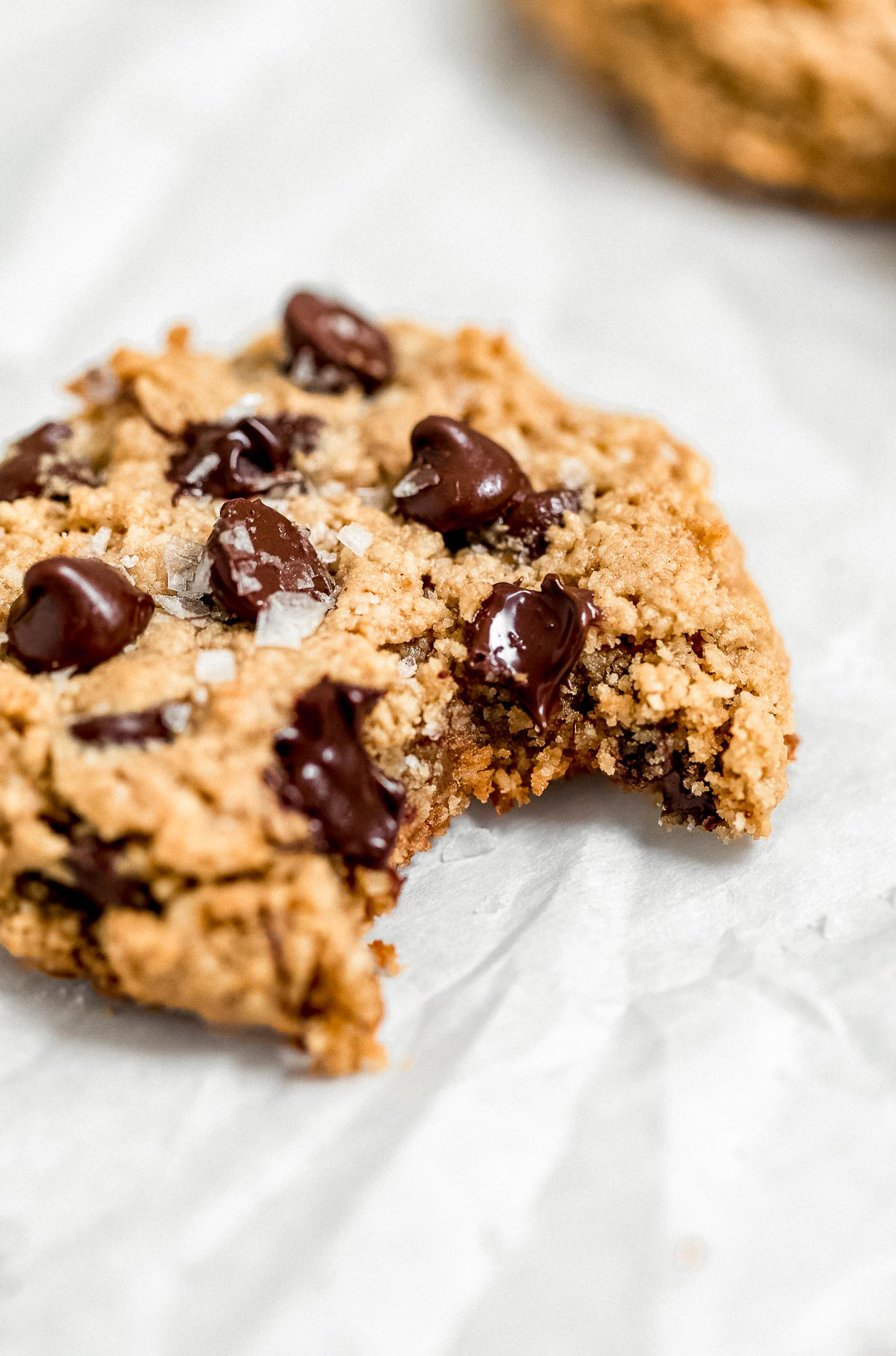 Healthy chocolate chip cookie with a bite taken out to show texture.