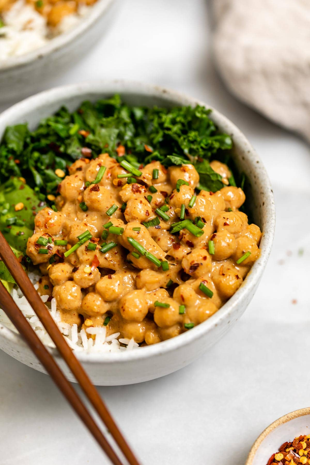 Peanut butter chickpeas with kale, rice and avocado.