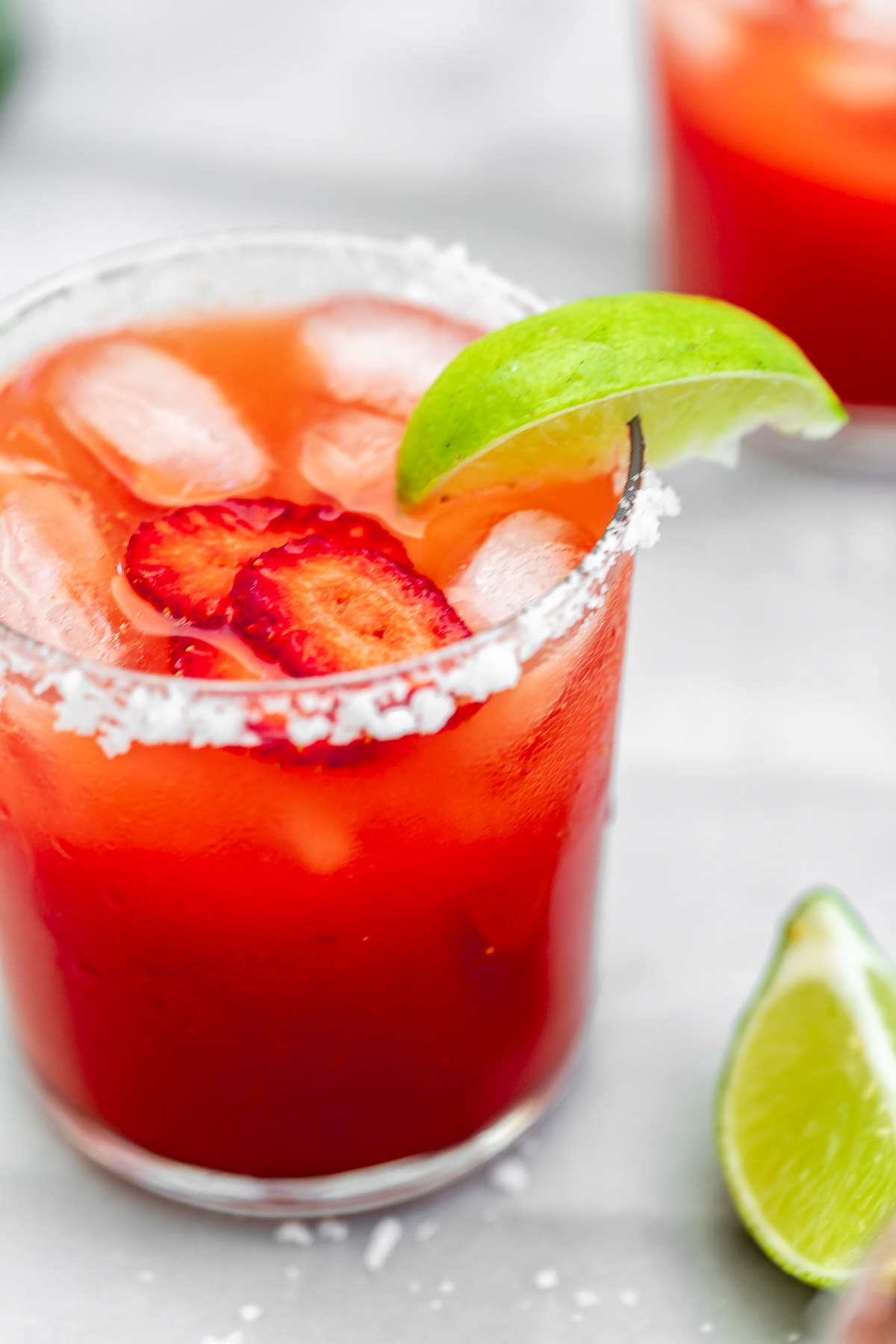 Up close image of the strawberry margarita with salt on the rim.