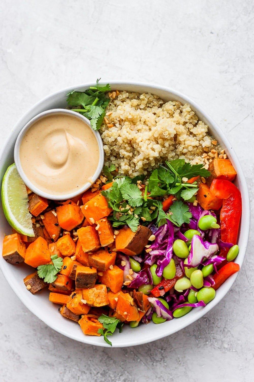 Quinoa coconut buddha bowl with rainbow veggies.