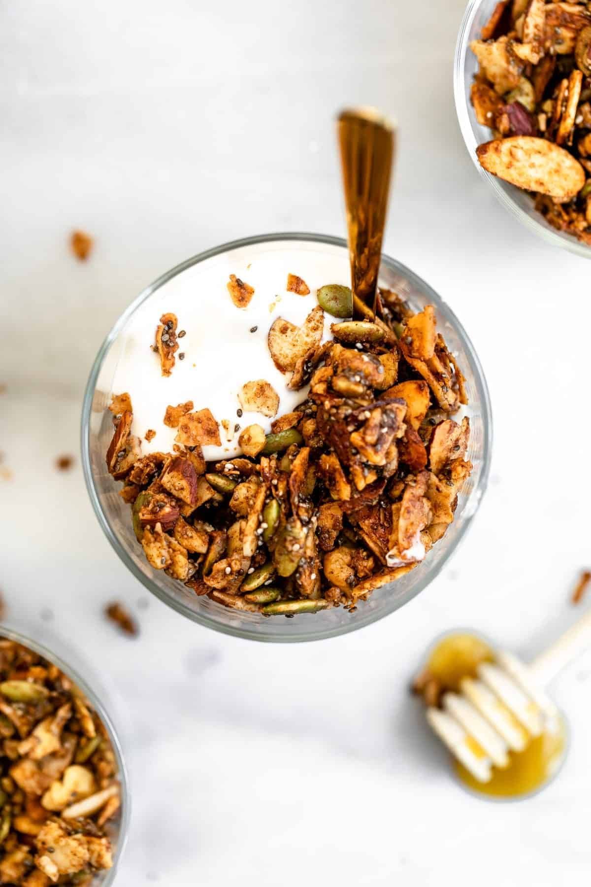Paleo granola with honey on top in a small bowl.