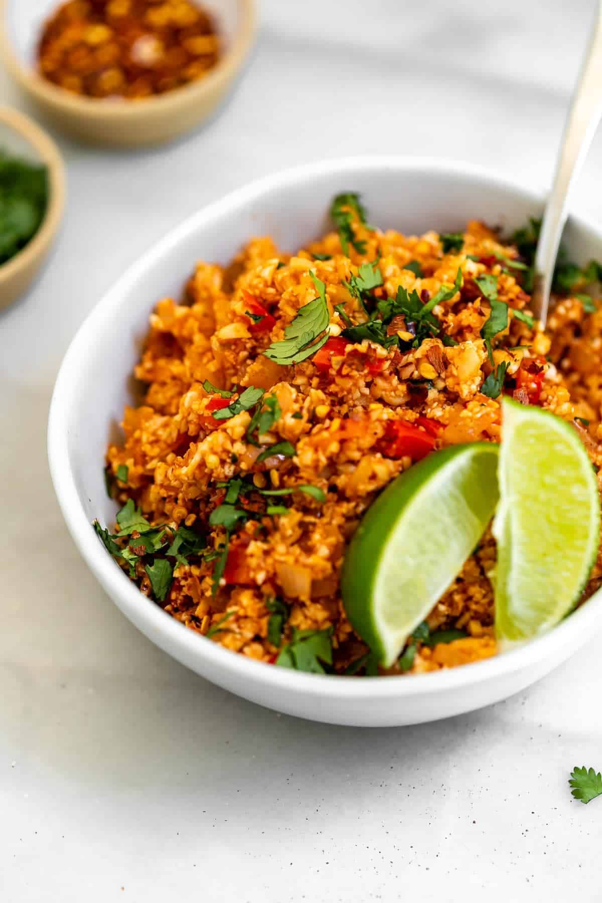 Vegan mexican cauliflower rice in a bowl with cilantro.