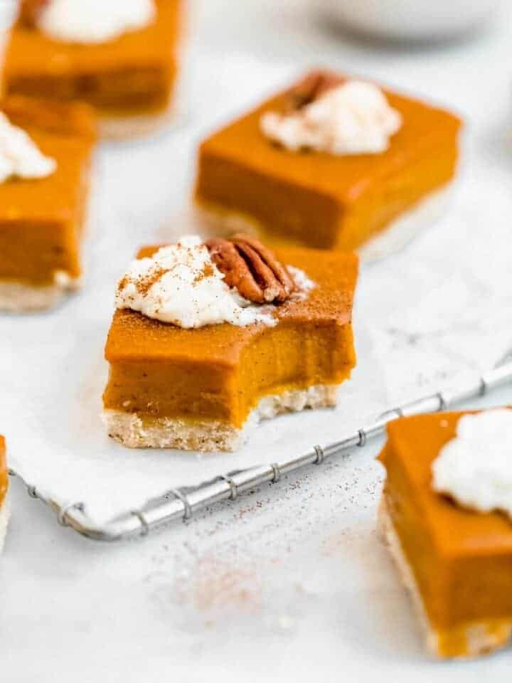 sweet potato pie bars with a bite taken out.