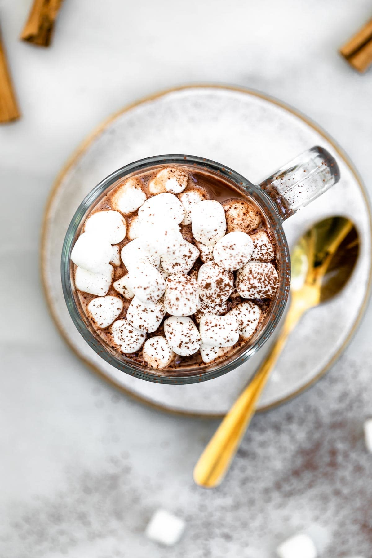 Overhead shot of the vegan hot chocolate with a spoon on the side.